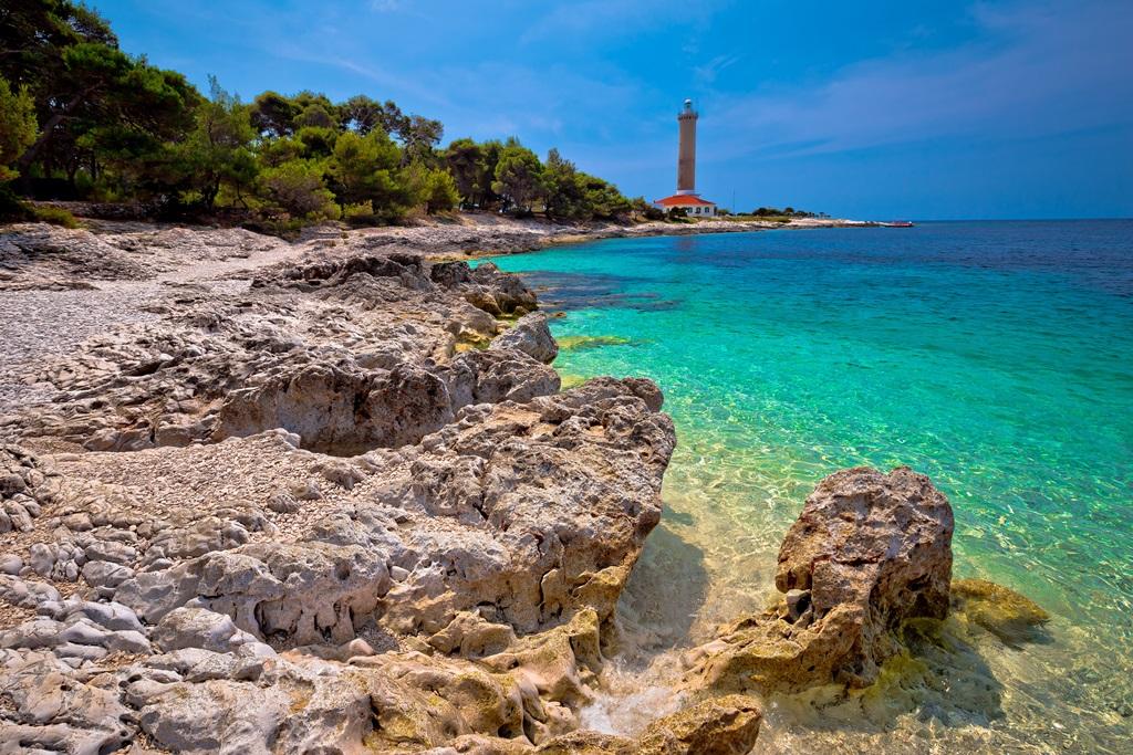 Veli Rat lighthouse and turquoise beach view Dugi Otok